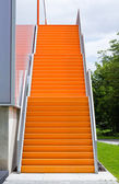 Orange steel stairway — Stock Photo