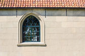 Church wall with a window — Stockfoto