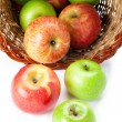 Apples spilling out of basket — Stock Photo #11372084