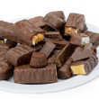 Chocolate bars on a white plate — Stock Photo