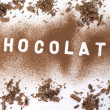 Chocolate powder forming a word — Stock Photo