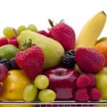 Fruit filled shopping basket — Stock Photo #11374095
