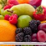 Fruit filled shopping basket — Stock Photo
