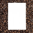 Piece of paper on heap of coffee beans — Stock Photo