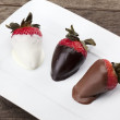 Strawberries with chocolate dip — Stock Photo