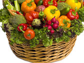Basket overflowing with vegetables — Stock Photo