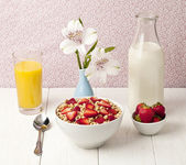 Bowl of cereals with strawberry juice and milk — Stock Photo