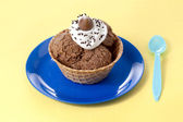 Chocolate ice cream with toppings — Stock Photo