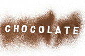 Chocolate powder on a white surface — Stock Photo