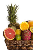 Cropped image of fruits in wicker basket — Stock Photo