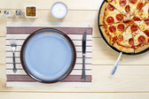 Top view of table utensil and pizza — Stock Photo