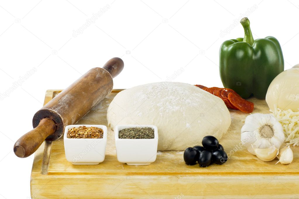 Rolling pin dough and pizza ingredients — Stock Photo #11374623