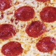 Extreme close up of pepperoni pizza — Stock Photo