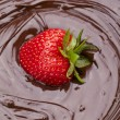 Stock Photo: Strawberry dipped on chocolate