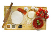 Ingredients for homemade pizza on wooden board — Stock Photo