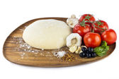 Pizza dough with ingredients — Stock Photo