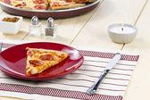 Pizza on restaurant table — Stock Photo