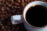 Tasse à café et grains de café — Photo