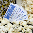 Stock Photo: Spilled popcorn with movie tickets