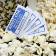 Spilled popcorn with movie tickets — Stock Photo