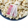Bowl with popcorn and two movie tickets — Stock Photo