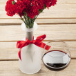 Royalty-Free Stock Photo: Red flower and wine decorated on table