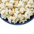 Cropped blue bowl of popcorn — Stock Photo