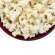 Cropped image of a popcorn inside the red bowl — Stock Photo