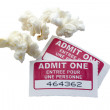 Cinema ticket with popcorn — Stock Photo