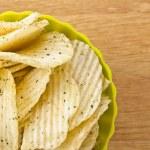 Fresh sour cream and onions potato chips — Stock Photo #12195432