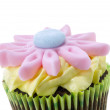 Cupcake with a flower on top — Stock Photo