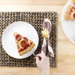 Putting pepperoni pizza on white plate — Stock Photo