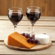 Stock Photo: Vertical image of cheese grapes and wineglass