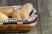 Cropped image of assorted bread in basket — Stock Photo