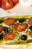 Close up cropped shot of a pizza with vegetables toppings — Stock Photo