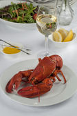 Lobster dinner with wine and vegetable salad — Stock Photo