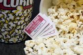 Macro movie pop corn with several tickets — Stock Photo