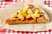 One slice of hawaiian pizza — Stock Photo