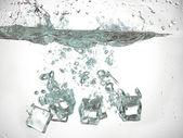 Ice cube dropped under the water — Stock Photo