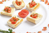 Plate of tomato bruschetta — Stock Photo
