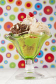 Green cup with ice cream — Stockfoto