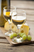 Portrait of wine with grapes and cheese — Stock Photo