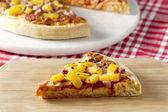 Slice of hawaiian pizza — Stock Photo