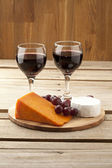 Vertical image of cheese grapes and wineglass — Stock Photo