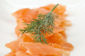 Slices of smoked salmon with dill — Stock Photo