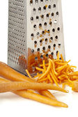Rub carrots and grater — Stock Photo