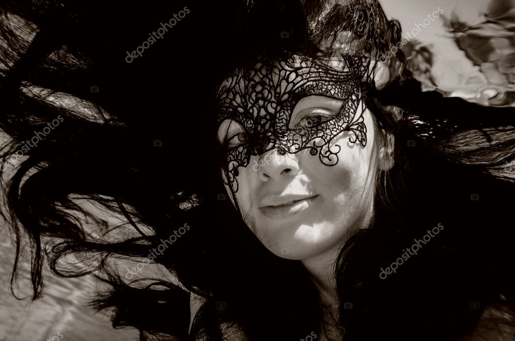 Portrait of a mysterious mask woman — Stock Photo #11384453