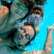 Family underwater play — Stock Photo