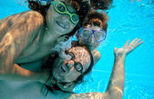 Family underwater play — Stock Photo