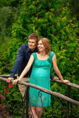 Happy young pregnant woman with young man — Stock Photo